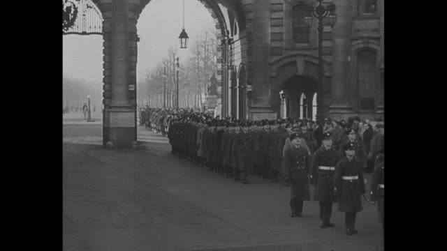 ls mounted soldiers ride away from buckingham palace during parade for airmen who participated in the berlin airlift / admiralty arch / parade passes... - 1949 stock videos and b-roll footage