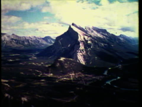 1953 WS PAN Mounties on horseback in Canadian mountain range / Canada / AUDIO