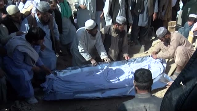 mourners attend a funeral in quetta the provincial capital and of balochistan in western pakistan for niaz muhammad and his son two of four people... - karachi stock videos & royalty-free footage