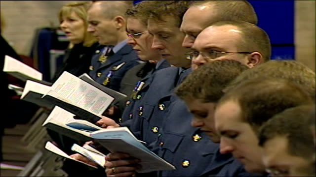 mourners attend memorial for british airmen who died in nimrod reconnaissance plane crash raf personnel singing at memorial service in two hangar for... - padre stock videos & royalty-free footage