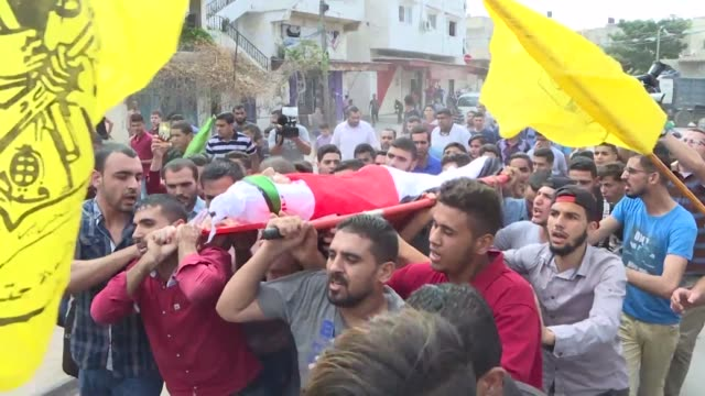 Mourners attend the funeral in Beit Lahia of Ahmed Abu Habel a Palestinians teenager who succumbed to a head wound after being hit with a tear gas...