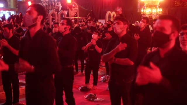 mourners beat themselves while taking part in a religious ceremony to commemorate ashura in a holy shrine in northern tehran on august 30 amid the... - ashura muharram stock videos & royalty-free footage