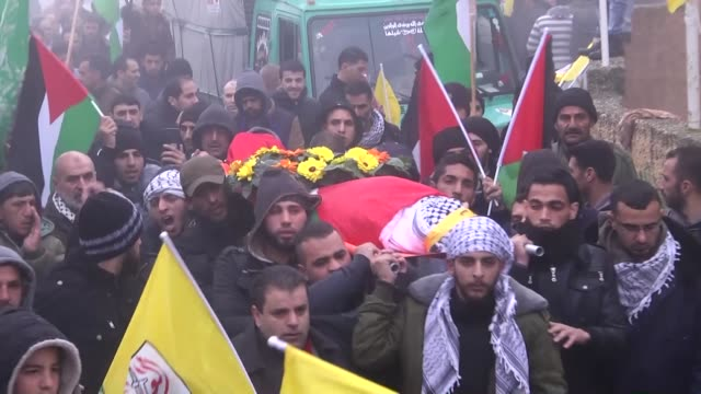 Mourners carry the bodies of Palestinian Mansour Shawamra and Omar Mohammed Amr during their funeral on February 23 2016 in the West Bank village of...