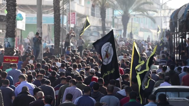 mourners chant slogans as they carry the body of palestinian islamic jihad senior leader baha abu al-ata during his funeral in gaza city on november... - jihad stock videos & royalty-free footage