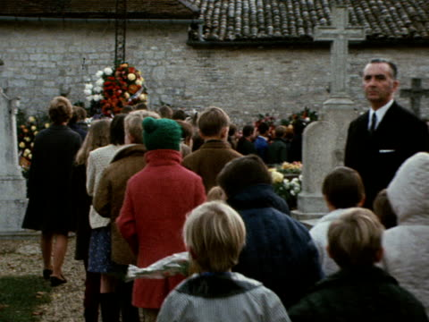 mourners file past the grave of charles de gaulle in the village of colombey les deux eglises november 1970 - charles de gaulle stock videos and b-roll footage