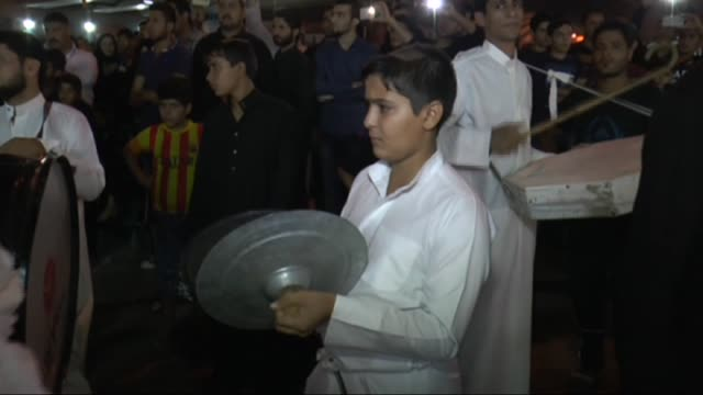mourners from across the globe are flocking to the iraqi city of karbala on october 24 2015 to mark the martyrdom anniversary of imam hussein the... - imam hussein stock videos and b-roll footage