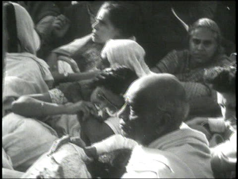mourners gather around the body of mahatma gandhi after his assassination in 1948. - mourner stock videos & royalty-free footage