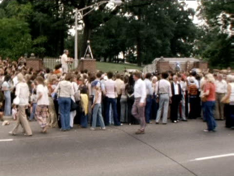mourners gather at graceland following death of elvis presley; 1977 - mourning stock videos & royalty-free footage
