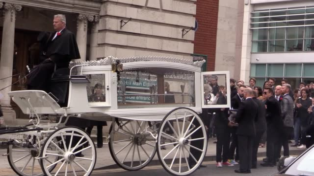 mourners gather at the funeral service of martyn hett who was killed in the manchester arena bombing at stockport town hall plaza - stockport bildbanksvideor och videomaterial från bakom kulisserna
