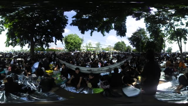 mourners gather in bangkok for the cremation of king bhumibol the funeral of the much loved king is taking place around bangkok's grand palace the... - king of thailand stock videos and b-roll footage