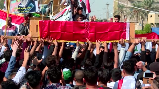 mourners hold a funeral for an iraqi demonstrator killed in anti government protests in the southern city of karbala - karbala stock videos & royalty-free footage
