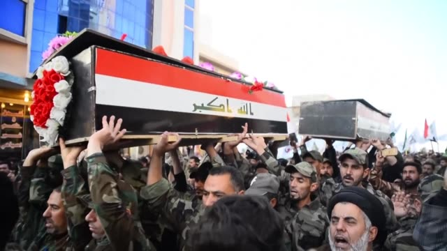 mourners hold the funeral procession in the holy city of najaf for members of hashed alshaabi who were killed on sunday following a us air strikes on... - najaf stock videos & royalty-free footage