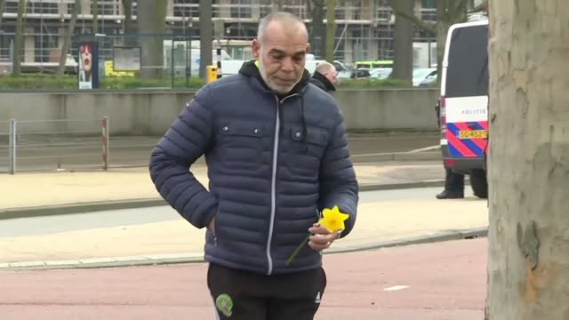 mourners lay flowers and pay respects at the site of yesterday's gun attack on a utrecht tram - utrecht stock videos & royalty-free footage