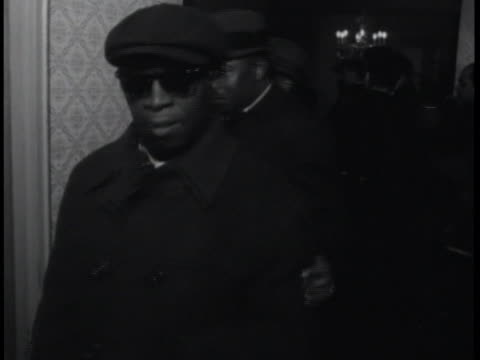 mourners line up to view malcolm x's body at unity funeral home in harlem, new york. - morte video stock e b–roll