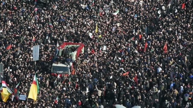 mourners surround the coffins of iranian general qassem soleimani and others killed in the u.s. airstrike during a funeral ceremony in tehran, iran,... - funeral stock videos & royalty-free footage