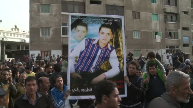 mourners turned out on friday for the funeral of protesters killed in clashes in egypts port said a day before a court is to issue verdicts over the... - port said stock videos and b-roll footage