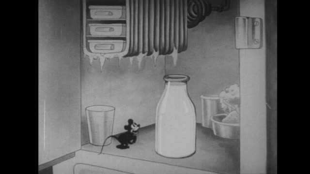 mouse jumps into a bottle of milk and drinks it all - frigorifero video stock e b–roll
