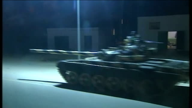 vídeos y material grabado en eventos de stock de moussa koussa defection to uk; tripoli: night libyan army tanks on street tracking shots - abandonar