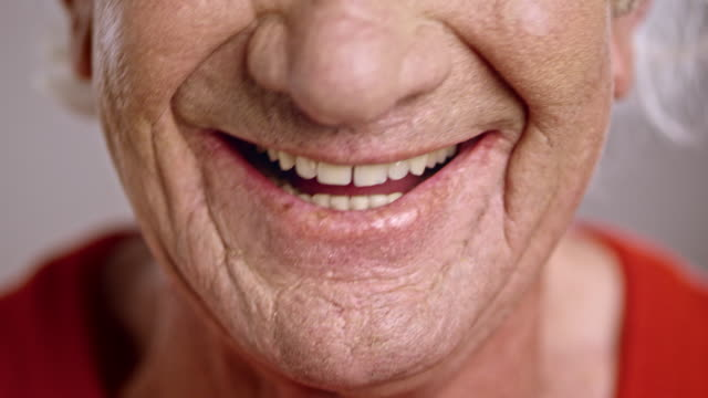 mouth of a laughing senior caucasian man - toothy smile stock videos & royalty-free footage