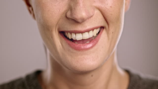 Mouth of a laughing young Caucasian woman