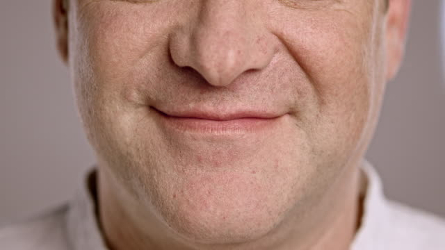 mouth of a smiling caucasian man - content stock videos & royalty-free footage