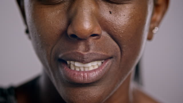 mouth of a stressed african-american woman - lips stock videos & royalty-free footage