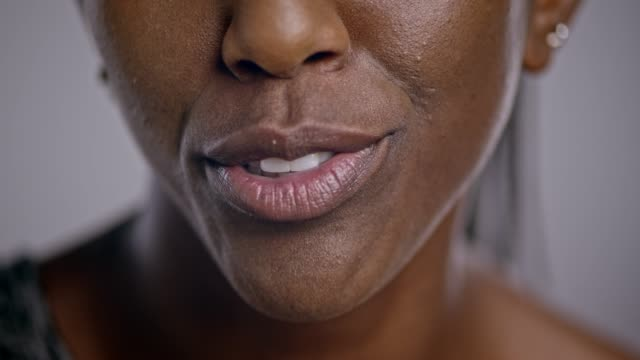 mouth of an african-american woman talking - close up stock videos & royalty-free footage