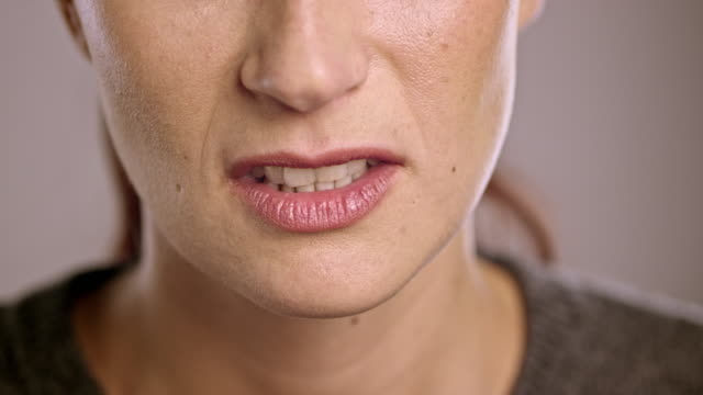 mouth of an angry young caucasian woman - lips stock videos & royalty-free footage