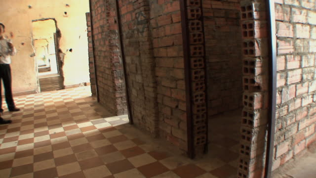 ms move across brick cells in tuol sleng school, phnom penh, cambodia - genocide stock videos & royalty-free footage