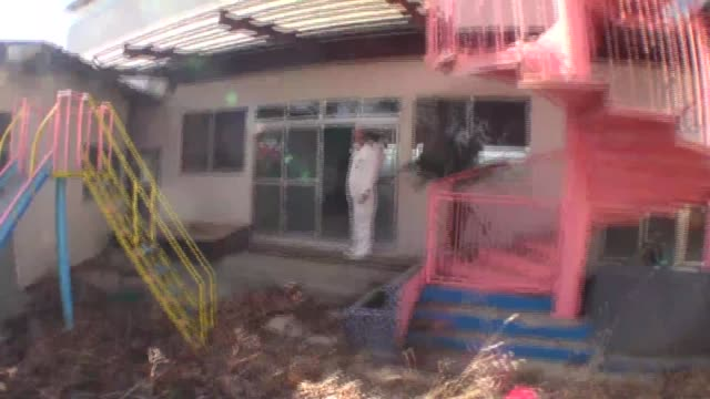 Move from school playground into deserted elementary school in mandatory exclusion zone following Fukushima Daiichi nuclear plant accident in Japan