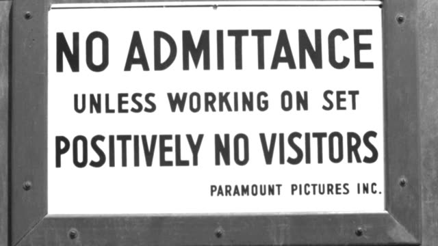 "nx - move in to c.u. sign on door:  ""no admittance unless working on set - positively no visitors - paramount pictures pictures inc."" - paramount pictures studio - b&w. - paramount pictures stock videos & royalty-free footage"