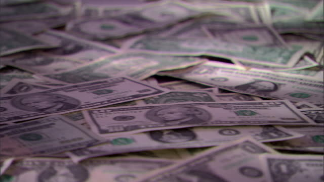 move left across us money strewn in a pile. - twenty us dollar note stock videos & royalty-free footage