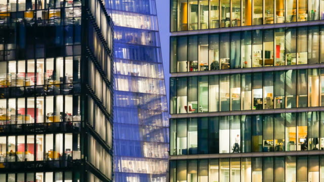 Movement of businessman meeting & working, Office business building in London, England - timelapse