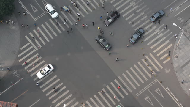 movement of cars and pedestrians at crossroads in beijing, china. - road intersection stock videos & royalty-free footage