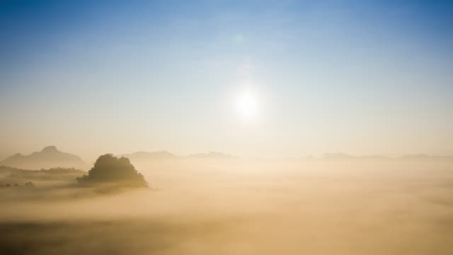 Movement of cloud and fog at sunrise time in the morning