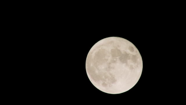 movement of the full moon in the sky - image stock videos & royalty-free footage