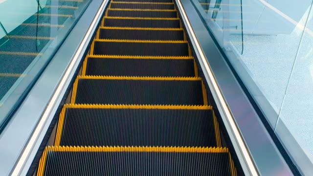 movement on the escalator seamless loop - escalator stock videos & royalty-free footage