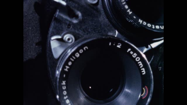 vídeos y material grabado en eventos de stock de cu movie camera lenses rotating - cámara cinematográfica