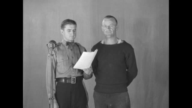 a movie cameraman with two men standing at a backdrop with a microphone overhead / sot a new jersey state policeman stands next to a criminal and... - 1904 stock videos & royalty-free footage