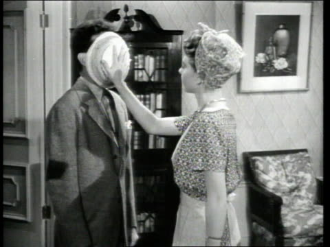 1947 MS Movie director prepares actress for scene in which she throws pie into actor's face / Hollywood, California, United States