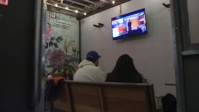movie fans attend oscars watch party at the stuart & cinema cafe and parklife, in brooklyn, new york, u.s., april 25, 2021. - oscar party stock videos & royalty-free footage