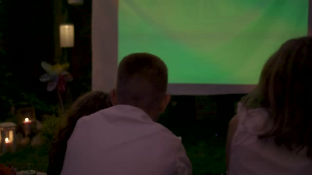 movie night in backyard - projection stock videos & royalty-free footage