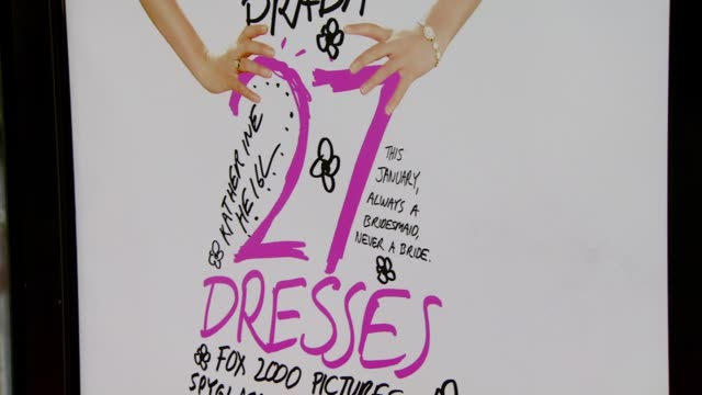 movie posters at the '27 dresses' premiere at the mann village theatre in westwood california on january 7 2008 - regency village theater stock videos & royalty-free footage