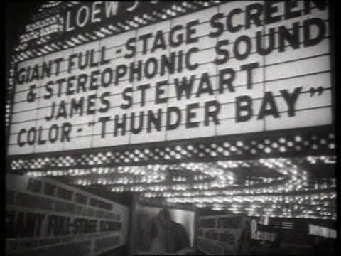 b/w 1954 movie premiere thunder bay with marquee and crowd / no sound - 1954 bildbanksvideor och videomaterial från bakom kulisserna
