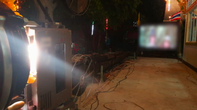 movie projector operating outdoor - film feeder stock videos & royalty-free footage
