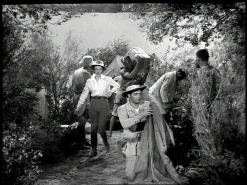 stockvideo's en b-roll-footage met 1947 ws movie scene from queen of the amazons of people preparing to go on safari into the jungle - 1947