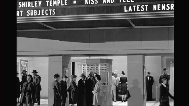 vidéos et rushes de cs movie theater marquee past ticket booth and doors into interior of movie theater / people seated watching screen movie theater exterior and... - équipement de projection