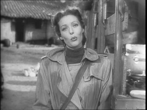 movie theater recruitment psa / actress loretta young on the set of 'china', loading guns into back of truck / loretta young's addresses camera on... - 1942 stock videos & royalty-free footage