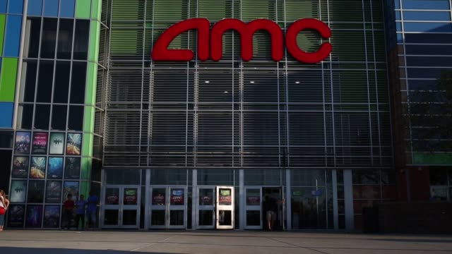 Moviegoers arrive at an AMC Entertainment Inc movie theater in West Chester Ohio US on Saturday July 30 2016 Shots full shot of AMC with logo on...