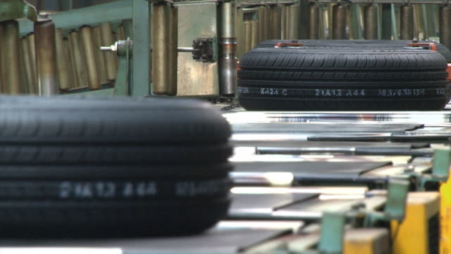 moving a tire on the conveyer belt - tyre stock videos & royalty-free footage